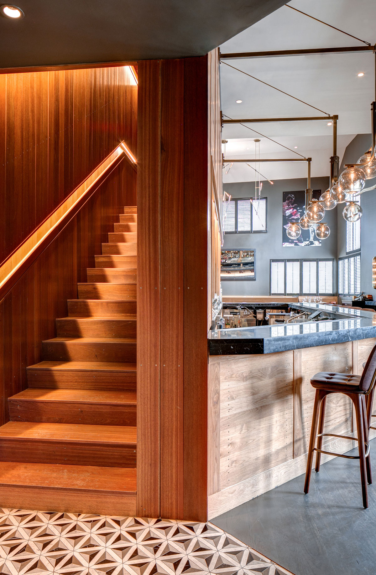 Stairs of the American Cut Bar & Grill project located at 495 Sylvan Avenue in Englewood Cliffs, New Jersey designed by the architecture studio Danny Forster & Architecture