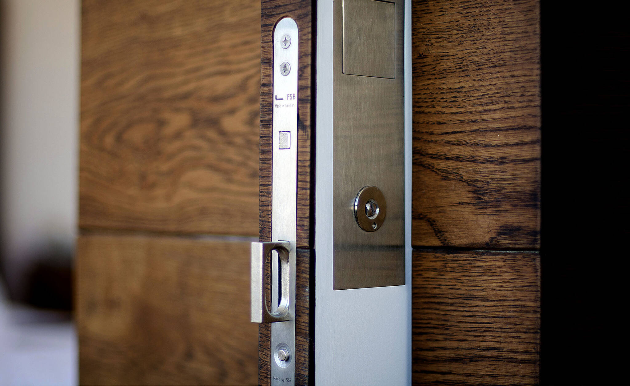 Detail of the privacy lock of the pocket door that divide the living room and the bedroom of the residence renovation project in the Chelsea Mews building on the Flatiron District in Manhattan, New York City designed by the architecture studio Danny Forster & Architecture