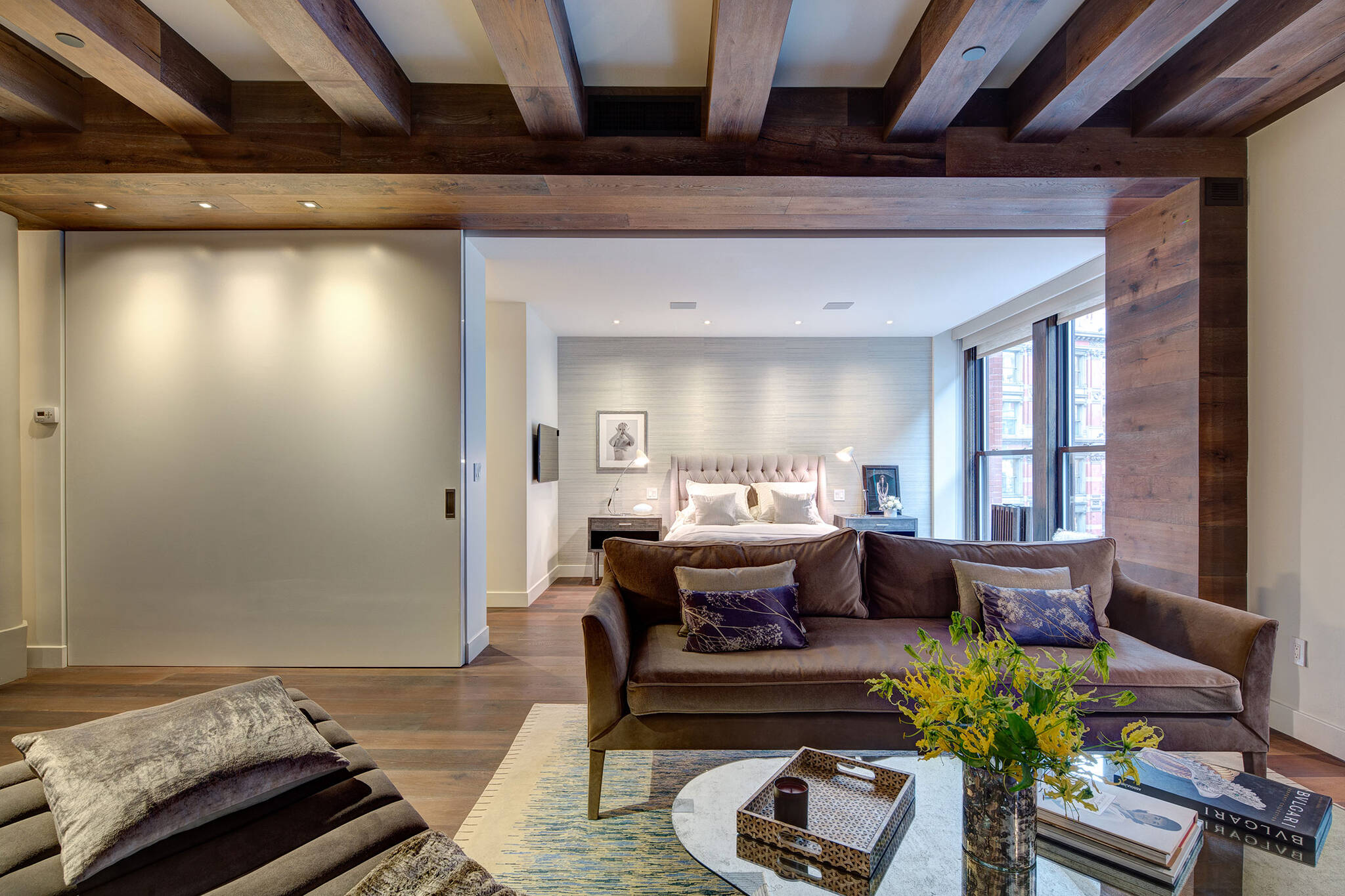 Sequence of the sliding doors dividing the space between the living room and the guest bedroom of the loft renovation project in Union Square, New York City designed by the architecture studio Danny Forster & Architecture