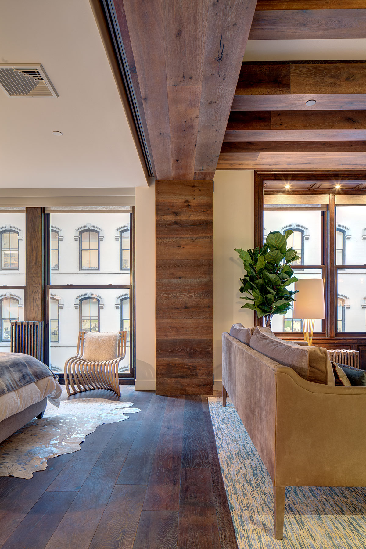 Russian oak wooden beam and cross beams dividing the space between the living room and the guest bedroom of the loft renovation project in Union Square, New York City designed by the architecture studio Danny Forster & Architecture
