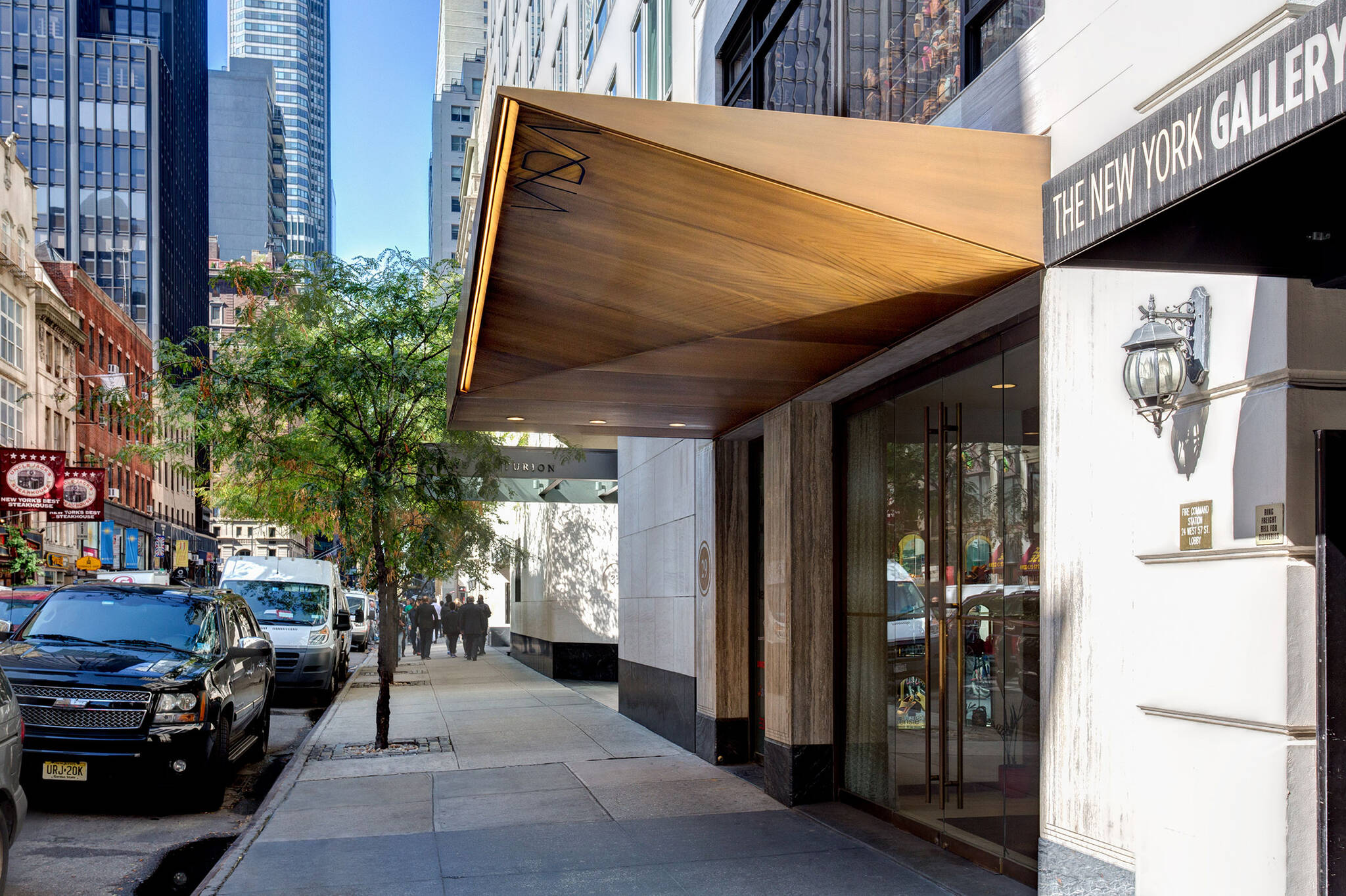 Sidewalk view of the Vida Shoes International canopy project for the shop located at 29 West 56th Street in Midtown, New York City designed by the architecture studio Danny Forster & Architecture