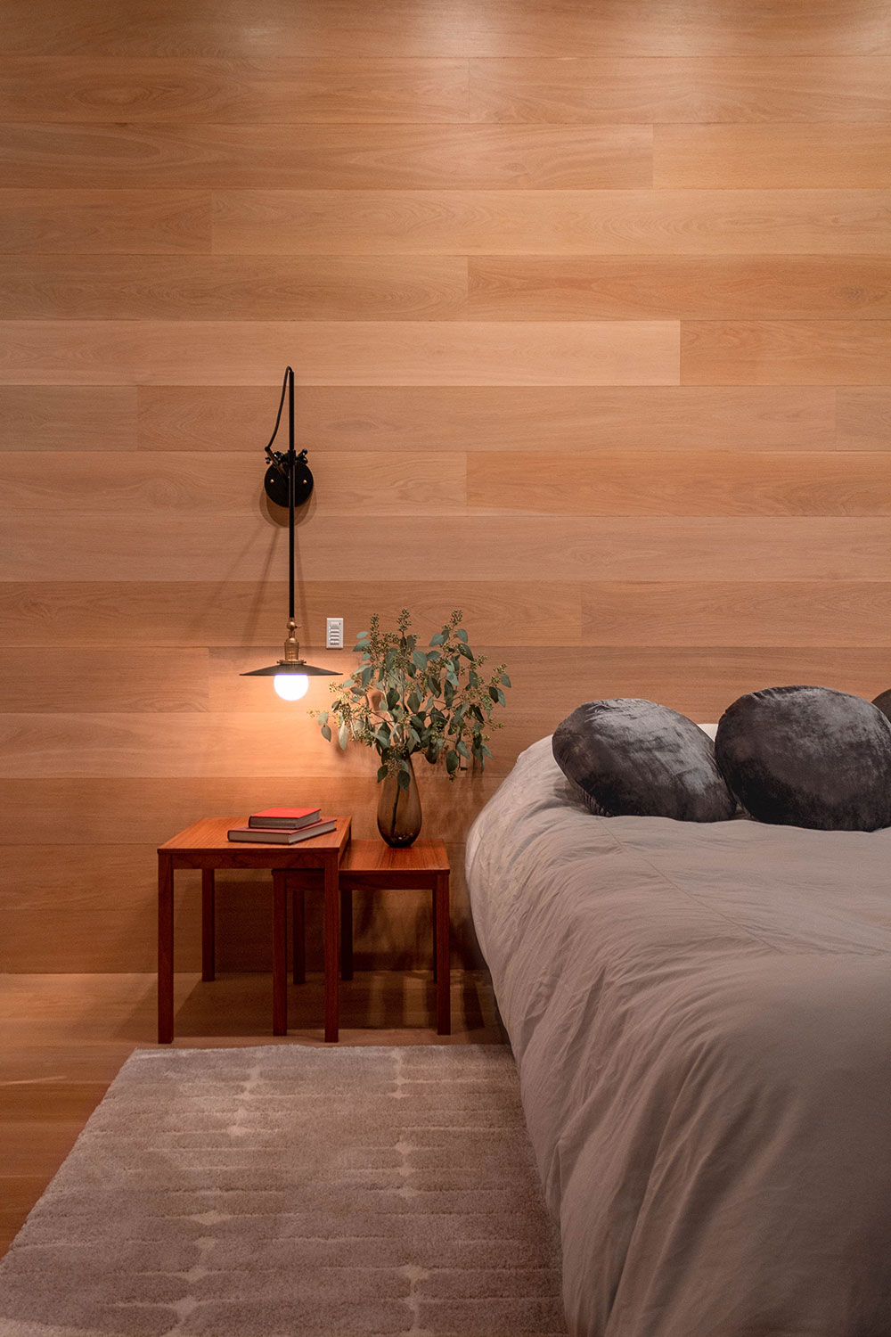 Detail of the bedside tables in the master bedroom of the Loft renovation project in Chelsea, New York City designed by the architecture studio Danny Forster & Architecture