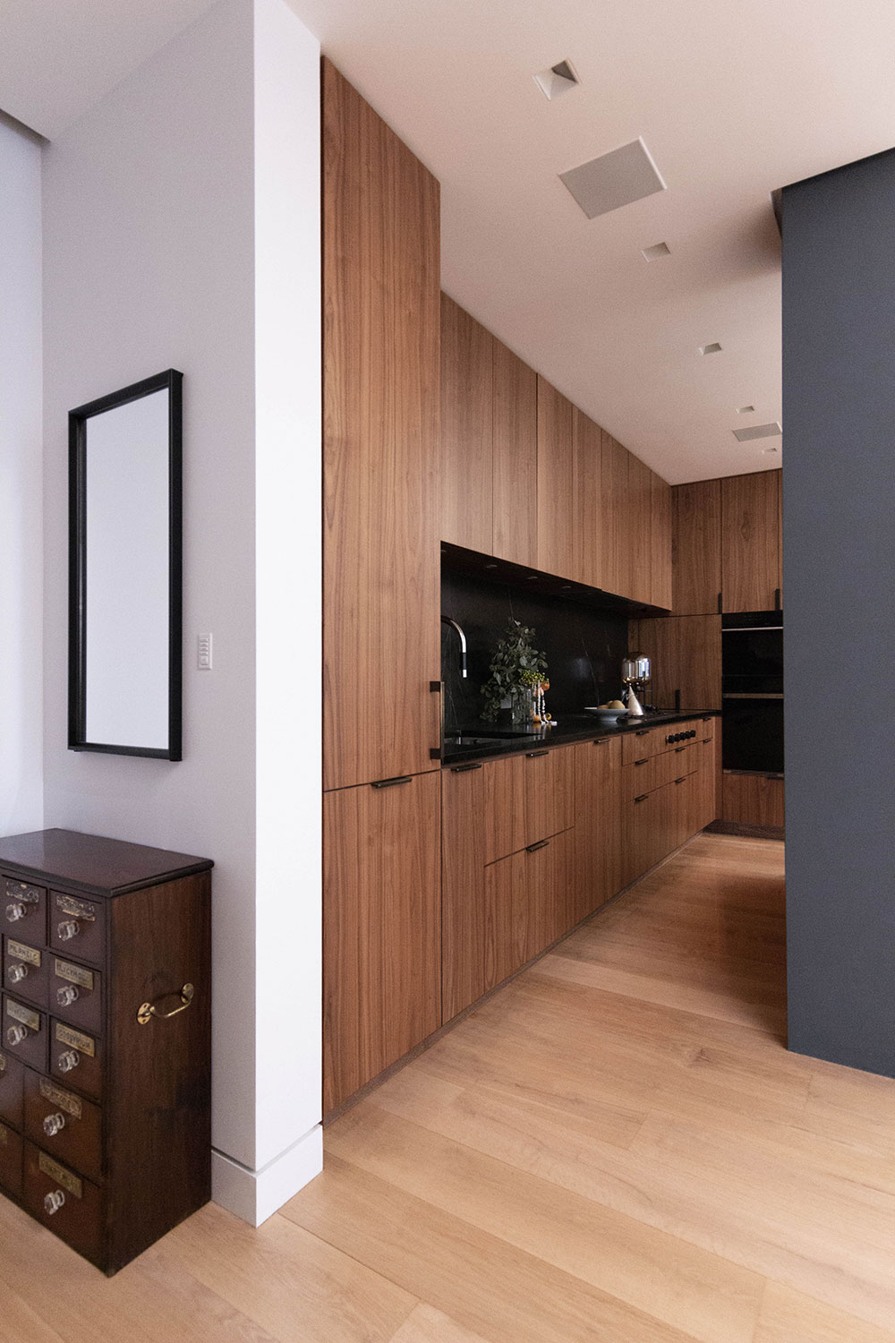 Kitchen entrance of the Loft renovation project in Chelsea, New York City designed by the architecture studio Danny Forster & Architecture