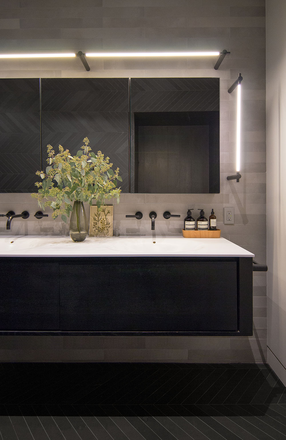 Detail of the vanity and lighting on the master bathroom of the Loft renovation project in Chelsea, New York City designed by the architecture studio Danny Forster & Architecture